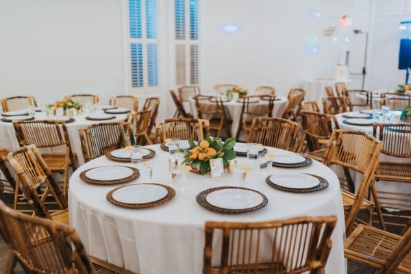 bamboo folding chairs at an indoor wedding reception
